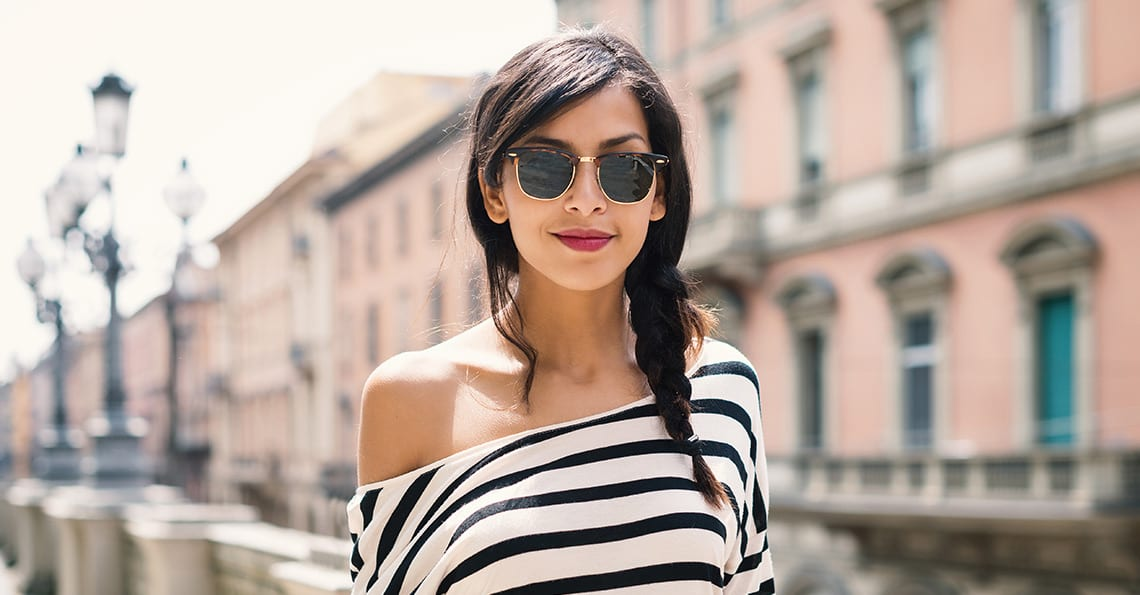 Woman wearing designer sunglasses