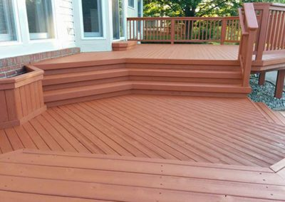 a deck with a red paint color