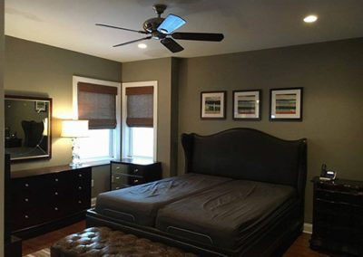 a bedroom with grey painted walls