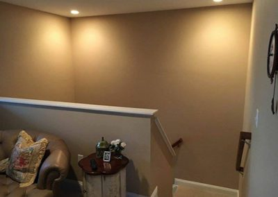 a stairway area with new painted brown walls