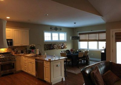 a kitchen and dining area with new painted walls