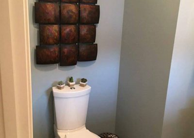 a bathroom with blue painted walls