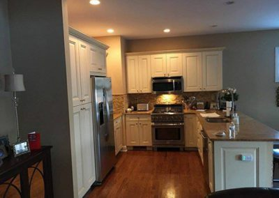 a kitchen with gray painted walls