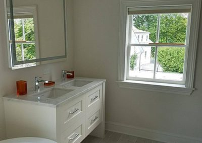 Bathroom with white painted walls