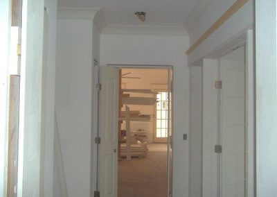 a hallway painted with a white color