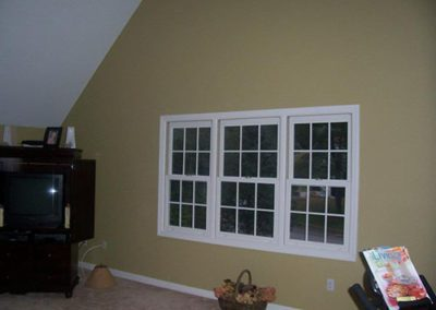 a wall with a window and white trim