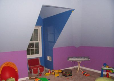child's bedroom with purple, blue and white paint