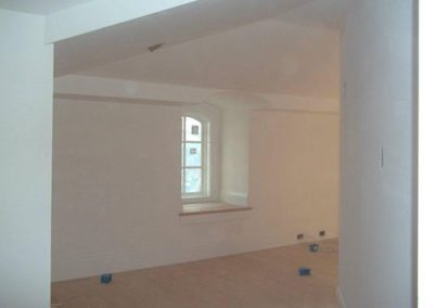 an empty room with new white paint