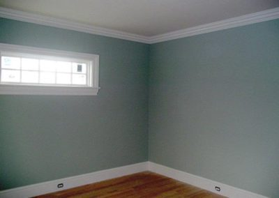 an empty room with blue paint on walls