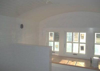 a room with white painted walls