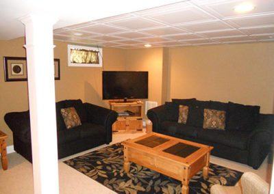 A finished basement, with furniture and new paint