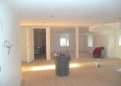 a finished basement getting painted
