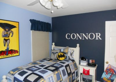 A childs bedroom with a Batman theme