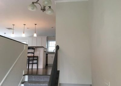 white painted walls in a stairway