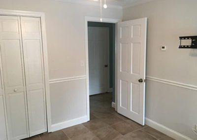 an empty bedroom with new painted walls