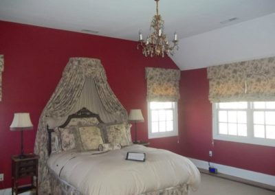 A master bedroom with red painted walls