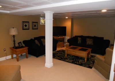 A finished basement, with furniture
